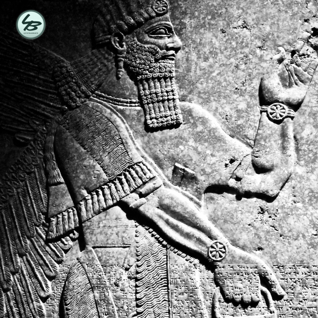 Letstalkbeats proprietary picture of a slab of stone with the image of a mythical man writing in Mesopotamia.